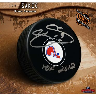 Joe Sakic Autographed Quebec Nordiques Puck with HOF 2012 Inscription